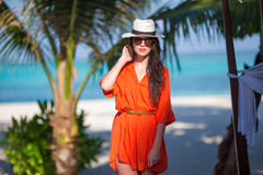 Young beautiful woman on tropical beach vacation Stock Photos
