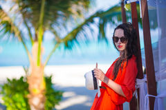 Young beautiful woman on tropical beach vacation Royalty Free Stock Images