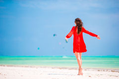 Young beautiful woman during tropical beach vacation Stock Image