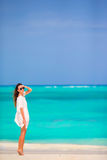 Young beautiful woman during tropical beach vacation Stock Photos