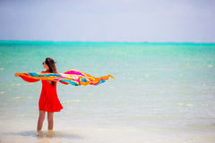 Young beautiful woman during tropical beach vacation. Young beautiful woman relaxing at white sand tropical beach Royalty Free Stock Image
