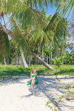 Young beautiful woman on tropical beach Stock Images