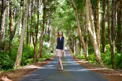 Young beautiful woman on a tropical island. Young beautiful woman in a tropical park Stock Photography