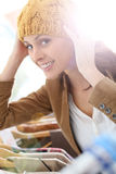 Young beautiful woman trying on a hat Stock Photos