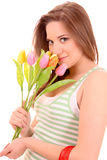 Young beautiful woman with tulips isolated Stock Photo