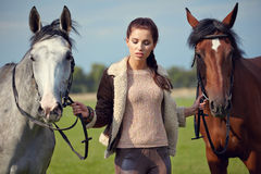 Young beautiful woman and two horses Stock Photo