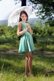 Young beautiful woman with umbrella in the park Royalty Free Stock Images