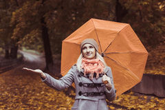 Young beautiful woman with umbrella posing outside at fall time Stock Photo