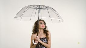 Young beautiful woman with an umbrella. stock video footage