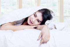 Young beautiful woman under blanket Stock Photo