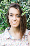 Young beautiful woman under an olive tree Royalty Free Stock Photos