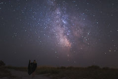 Young beautiful woman  under stars of Milky Way Galaxy. Young beautiful woman  under stars of Milky Way Royalty Free Stock Photography