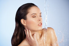 Young beautiful woman under the stream of water Royalty Free Stock Photo