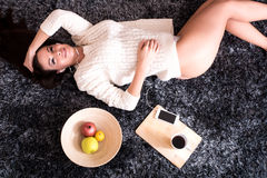Young beautiful woman in underwear listening to music Stock Photos