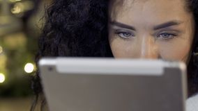 Young beautiful woman uses digital tablet. The girl is reading something and searching in the internet. Close-up stock video