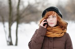 Young beautiful woman using her mobile phone Royalty Free Stock Photos