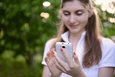 Young Beautiful Woman Using her Smart Phone Outdoor Stock Photos