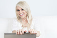 Young beautiful woman using a laptop computer at Royalty Free Stock Images