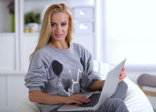 Young beautiful woman using a laptop computer at Stock Images