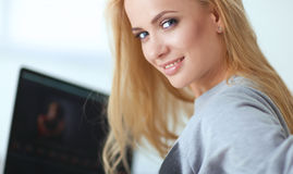 Young beautiful woman using a laptop computer at home Stock Photos