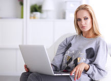 Young beautiful woman using a laptop computer at home Royalty Free Stock Photo