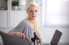 Young beautiful woman using a laptop computer at home Royalty Free Stock Photography