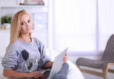 Young beautiful woman using a laptop computer at home Stock Image