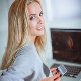 Young beautiful woman using a laptop computer at home Royalty Free Stock Images