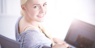 Young beautiful woman using a laptop computer at home Stock Photo