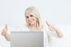 Young beautiful woman using a laptop computer at Royalty Free Stock Photo