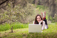 Young beautiful woman using a laptop computer at the park Stock Images