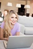 Young beautiful woman using a laptop at home Royalty Free Stock Photo