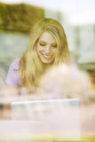 Young beautiful woman using a laptop at home Royalty Free Stock Image
