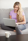 Young beautiful woman using a laptop at home Royalty Free Stock Images