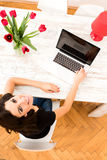 Young beautiful woman using a Laptop at home Royalty Free Stock Photography