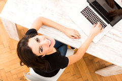 Young beautiful woman using a Laptop at home Stock Photos