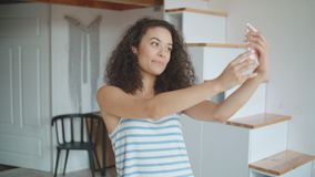 Young woman taking selfie by mobile phone in kitchen. stock footage