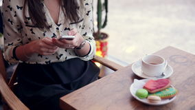 Young beautiful woman using phone sitting in stylish cafe. Full HD stock video