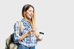 Young beautiful woman using smart phone. Young beautiful student using smart phone Stock Photography