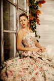 Young beautiful woman in vintage dress on autumn porch. Beauty g Stock Image