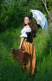Young beautiful woman in vintage dress with old su Royalty Free Stock Photos