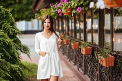 Young beautiful woman visiting a city center during a sunny day. royalty free stock photos