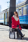 Young beautiful woman waiting for train on the platform Stock Images