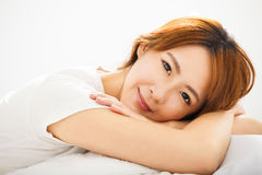 Young beautiful Woman Waking Up In Bed Royalty Free Stock Images