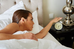 Young beautiful, woman waking up Stock Photo