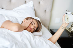 Young beautiful, woman waking up Royalty Free Stock Image