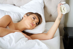 Young beautiful, woman waking up Royalty Free Stock Photography