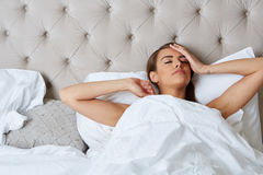 Young beautiful, woman waking up Stock Photos