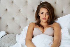Young beautiful, woman waking up Royalty Free Stock Photos