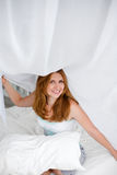 Young beautiful woman waking up fully rested Stock Photo